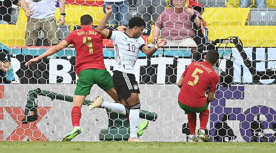 What bad luck! Raphael Guerreiro (Portugal) got in the way of a pass and unintentionally sent the ball past his own goalkeeper. The score is 1:2.